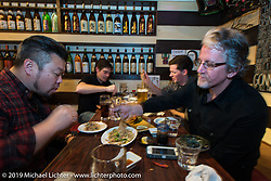 The last Tokyo supper for Harley-Davidson's (L>R) Dais Nagao, Charlie Wargow, Ben McGinley and Ray Drea. Japan. Wednesday, December 10, 2014. Photograph ©2014 Michael Lichter.
