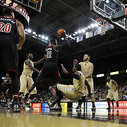 UCF Knights guard Isaiah Sykes (3) trips and Louisville Cardinals forward/center Mangok Mathiang (12) drives to the basket during an NCAA basketball game between the 14th ranked Louisville Cardinals and the UCF Knights at the CFE Arena on Tuesday, December 31, 2013 in Orlando, Florida. (AP Photo/Alex Menendez)