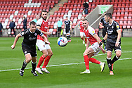 Tony Craig (24), Jordan Tunnicliffe (19) of Crawley Town, Andy Williams and William Boyle (15) of Cheltenham Town during the EFL Sky Bet League 2 match between Cheltenham Town and Crawley Town at Jonny Rocks Stadium, Cheltenham, England on 10 October 2020.