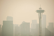 2018 AUGUST 20 - The Space Needle and downtown buildings are seen through smokey skies in Seattle, WA, USA. View from Kerry Park viewpoint. By Richard Walker