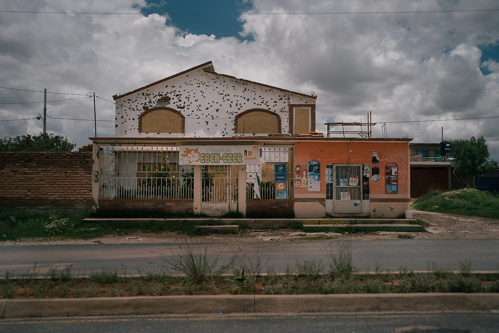 "Bullet holes riddle a house and grocery store in Juan Aldama, in Zacatecas after an attack. In northern Zacatecas, a faction of the Sinaloa cartel led by Ismael ""El Mayo"" Zambada has moved in. Gunmen in pickups have been seen cruising freely through the area, ""MZ"" emblazoned on their helmets or guns."