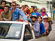 04 SEPTEMBER 2013 - BANGKOK, THAILAND:  Construction workers ride back to the dorms from their job site in a company provided pickup truck in Bangkok. Most of the construction workers in Bangkok are migrants either from the Isan region of northeast Thailand or Cambodia.      PHOTO BY JACK KURTZ