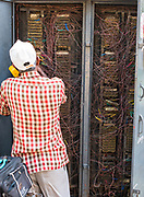 Man solving problem with a BSNL telecom switch box. Alappuzha, India South