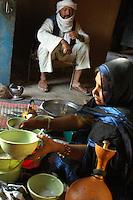Niger,Agadez,2007. Takita Ixa prepares breakfast in the doorway of her room at Mohammad Ixa's family home.