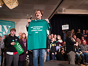 02 FEBRUARY 2020 - CEDAR RAPIDS, IOWA: Iowa State Senator LIZ MATHIS holds up an Amy Klobuchar tee shirt at a campaign event in Cedar Rapids. Sen. Klobuchar campaigned to support her candidacy for the US Presidency Sunday in Iowa. She is trying to capitalize on her recent uptick in national polls. Iowa holds the first selection event of the presidential election cycle. The Iowa Caucuses are Feb. 3, 2020.     PHOTO BY JACK KURTZ