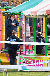 © Licensed to London News Pictures. 04/11/2018. Woking, UK. A police forensics team work next to a deflated slide in Woking Park after it collapsed injuring eight children. The park was holding a fireworks party when the accident happened. Photo credit: Peter Macdiarmid/LNP
