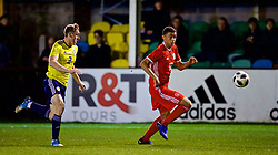 RHYL, WALES - Wednesday, November 14, 2018: Wales' Brennan Johnson and Scotland's Jordan Houston during the UEFA Under-19 Championship 2019 Qualifying Group 4 match between Wales and Scotland at Belle Vue. (Pic by Paul Greenwood/Propaganda)