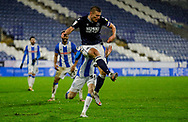 Millwall defender Shaun Hutchinson (4) clears during the EFL Sky Bet Championship match between Huddersfield Town and Millwall at the John Smiths Stadium, Huddersfield, England on 20 January 2021.