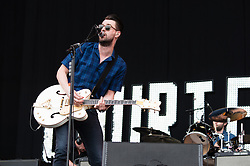© Licensed to London News Pictures. 14/06/2015. Newport, UK.   The Courteeners performing live at Isle of Wight Festival 2015, Day 4 Sunday.   In this picture- Liam Frey.  Headline acts include The Prodigy, Blur and Fleetwood Mac.   Photo credit : Richard Isaac/LNP