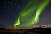 Aurora Borealis along with the volcano Hekla and mountain Búrfell, south Iceland