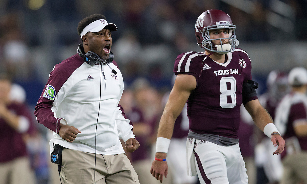 Texas A&M's head coach Kevin Sumlin celebrates a touchdown against Arkansas during the second quarter of an NCAA college football game Saturday, Sept. 24, 2016, in Arlington, Texas. (The Eagle/Sam Craft)