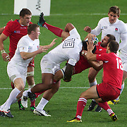 Manu Tuilagi, England, makes a tackle during the England V Georgia Pool B match during the IRB Rugby World Cup tournament. Otago Stadium, Dunedin New Zealand, 18th September 2011. Photo Tim Clayton..