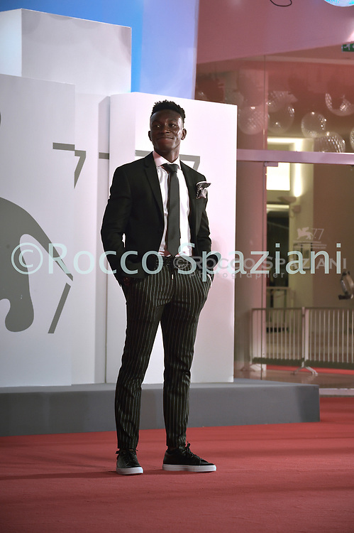 """VENICE, ITALY - SEPTEMBER 10: Olly Sholotanwalks the red carpet ahead of the movie """"Run Hide Fight"""" at the 77th Venice Film Festival on September 10, 2020 in Venice, Italy.<br /> (Photo by Rocco Spaziani)"""