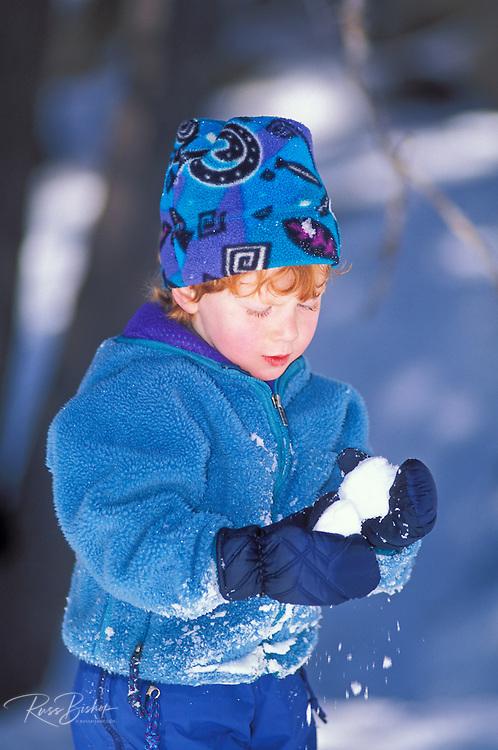 Child (age 3) making a snowball, San Bernardino National Forest, California