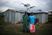 Nicholas and Faith Papei Saltaban in front of their hut near the Rift Valley, some two hours by car from Nairobi.