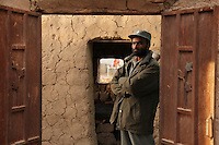 Prison guards at the entrance to the mud-walled jail in Tirin Kot, Oruzgan province.