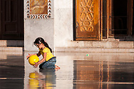 A girl plays with a yellow ball inside the Umayyad Mosque in Damascus, Syria.<br /> <br /> (June 15, 2010)