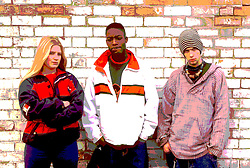 Multiracial group of teenagers standing together,
