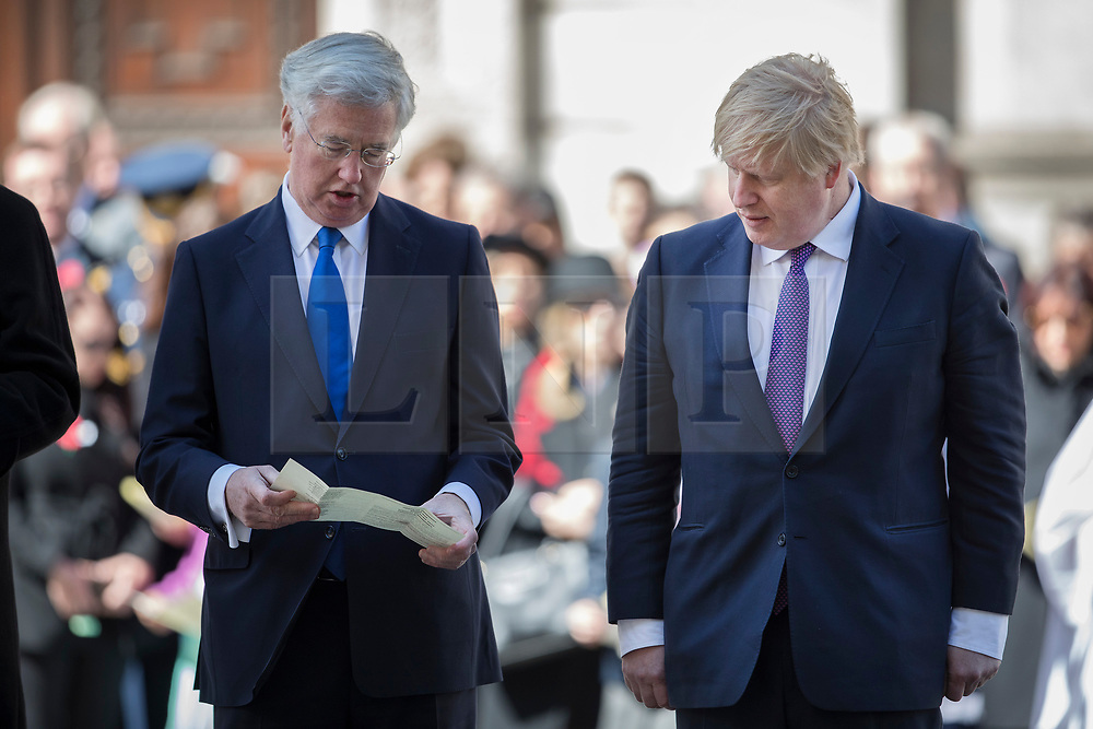 © Licensed to London News Pictures. 25/04/2017. London, UK. British Defence Sectretary Michael Fallon stands British Foreign Secretary Boris Johnson (R) during the ANZAC Day ceremony at the Cenotaph in Whitehall. A dawn ceremony and service was held at The Australian War Memorial and The New Zealand War Memorial at Hyde Park Corner.  April 25th is the day that Australia and New Zealand remember the dead of all wars. Photo credit: Peter Macdiarmid/LNP