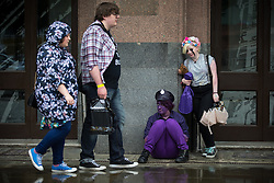 © Licensed to London News Pictures . 26/07/2015 . Manchester , UK . Cosplayers in the rain outside the venue . Comic Con convention at Manchester Central Convention Centre . Photo credit : Joel Goodman/LNP