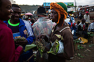 A local Khat seller in Maua offers his wares. Much of the town's population uses the drug, even children.
