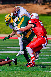 NORMAL, IL - October 16: Iverson Brown slows down Christian Watson enough for Kenton Wilhoit to put him on the turf during a college football game between the NDSU (North Dakota State) Bison and the ISU (Illinois State University) Redbirds on October 16 2021 at Hancock Stadium in Normal, IL. (Photo by Alan Look)