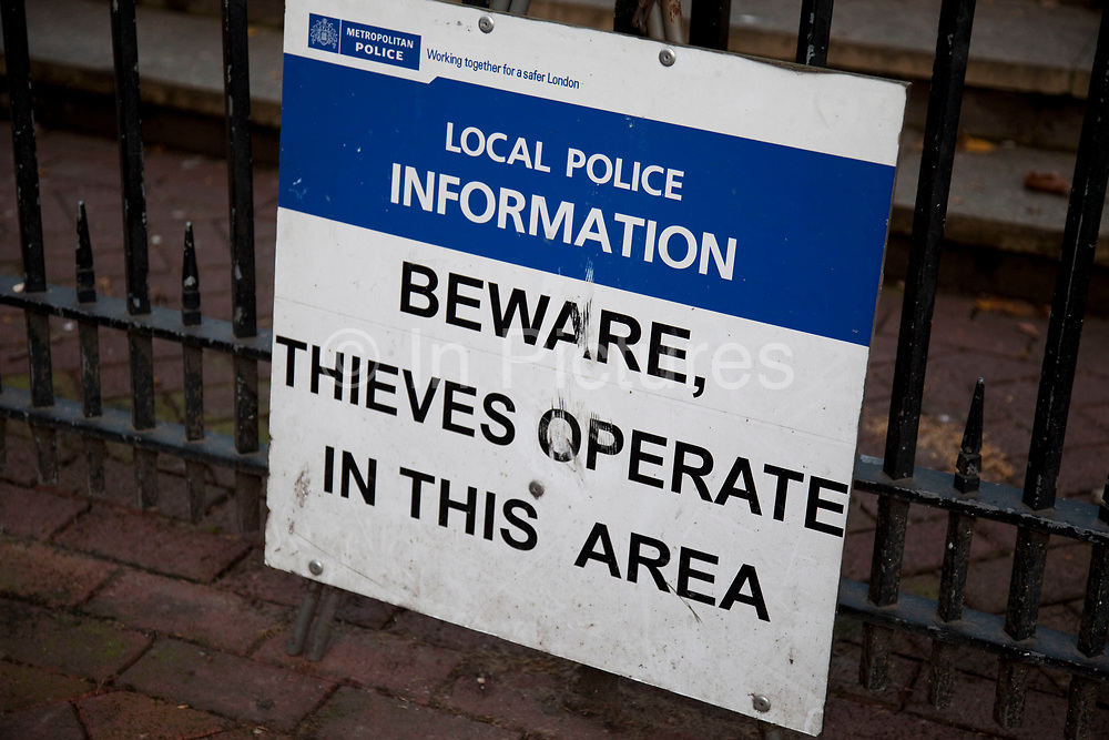 Police sign warns of thieves operating in the area.