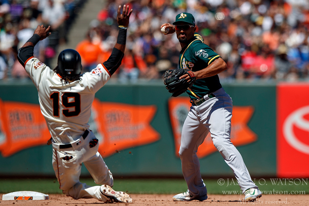 SAN FRANCISCO, CA - JULY 15: Marcus Semien #10 of the Oakland Athletics completes a double play over Alen Hanson #19 of the San Francisco Giants during the eighth inning at AT&T Park on July 15, 2018 in San Francisco, California. The Oakland Athletics defeated the San Francisco Giants 6-2. (Photo by Jason O. Watson/Getty Images) *** Local Caption ***