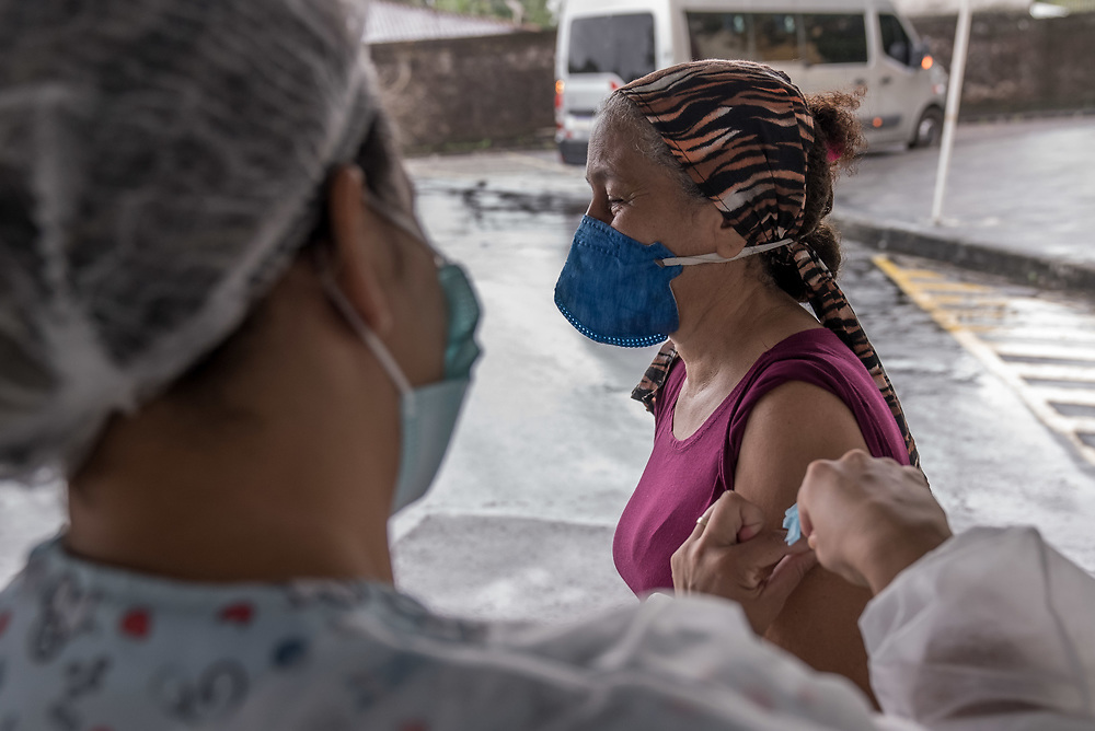 People receive the CoronaVac vaccine, also known as the Sinovac COVID-19 vaccine at Club Trabalhador/SESI in Manaus, Brazil March 30, 2021. CoronaVac is an inactivated virus COVID-19 vaccine developed by the Chinese company Sinovac Biotech and has been in Brazil's Phase III clinical trials. Photo Ken Cedeno