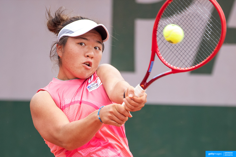 PARIS, FRANCE May 26.  En-Shuo Liang of Taipei in action against Asia Mohammad of the United States on day three of the qualifying tournament at the 2021 French Open Tennis Tournament at Roland Garros on May 26th 2021 in Paris, France. (Photo by Tim Clayton/Corbis via Getty Images)