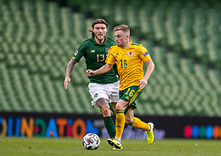 DUBLIN, REPUBLIC OF IRELAND - Sunday, October 11, 2020: Wales' Joseff Morrell (R) is challenged by Republic of Ireland's Jeff Hendrick during the UEFA Nations League Group Stage League B Group 4 match between Republic of Ireland and Wales at the Aviva Stadium. The game ended in a 0-0 draw. (Pic by David Rawcliffe/Propaganda)