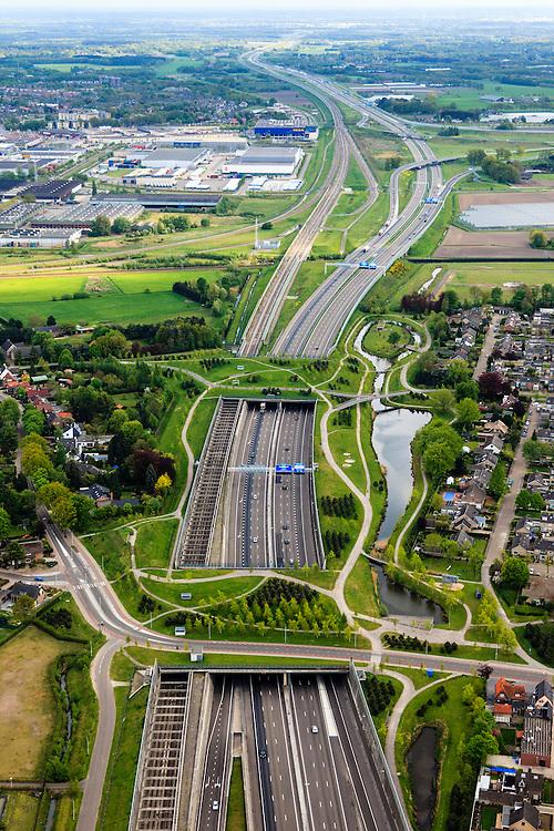 Nederland, Noord-Brabant, Breda, 09-05-2013; infrabundel, combinatie van autosnelweg A16 gebundeld met de spoorlijn van de HSL (re). Stadsduct Valbos in de voorgrond, gezien naar Stadsduct Overbos en knooppunt Princeville.<br /> De bundel loopt in tunnelbakken, lokale wegen gaan over deze infrabundel heen, door middel van de zogenaamde stadsducten, gedeeltelijk ingericht als stadspark. <br /> Combination of motorway A16 and the HST railroad, crossed by  local roads by means of *urban ducts*, partly designed as public  parks .<br /> luchtfoto (toeslag op standard tarieven);<br /> aerial photo (additional fee required);<br /> copyright foto/photo Siebe Swart.