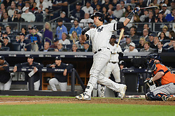 October 18, 2017 - Bronx, NY, USA - The New York Yankees' Gary Sanchez hits a solo home run in the seventh inning against the Houston Astros in Game 5 of the American League Championship Series at Yankee Stadium in New York on Wednesday, Oct. 18, 2017. (Credit Image: © Andrew Savulich/TNS via ZUMA Wire)