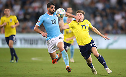 Israel's Omri Ben Harush and Scotland's James Forrest (right) battle for the ball during the UEFA Nations League Group C1 match at the Sammy Ofer Stadium, Haifa.