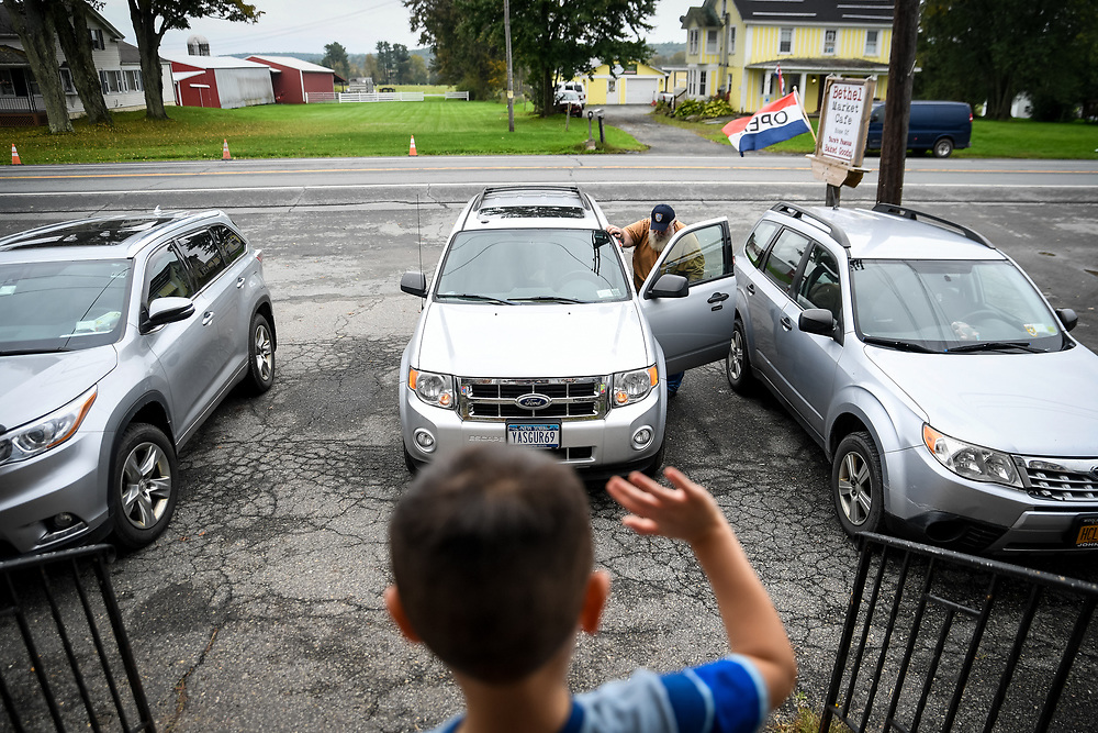A child waves to Duke as he leaves the Bethel Woods Cafe for his home.