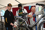 Niall O'Flynn and Al Baily service the bike of Paddy Lydon Salthill at the opening of the Galway Bike Festival on Saturday. Photo:-XPOURE.IE / NO FEE