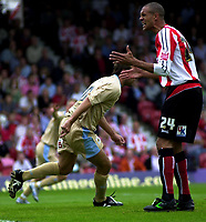 Photo: Catrine Gapper.<br /> Brentford v Bristol City. Coca Cola League 1.<br /> 24/09/2005.<br /> Junior Lewis venting his anger at Brentford's goal keeper, Stuart Nelson, on Bristol scoring goal.