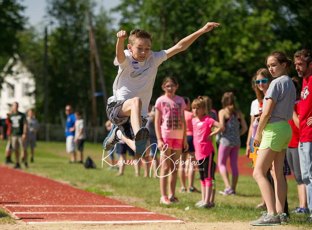 Matthew DeDuca from Woodland Heights Elementary School in the long jump during the 5th grade track meet at Opechee Park on Wednesday morning.  (Karen Bobotas/for the Laconia Daily Sun)