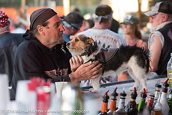 Ed Rieken (subject of Early Morning photograph) with his dog Jaxon at the Broken Spoke during the Daytona Bike Week 75th Anniversary event. FL, USA. Tuesday March 8, 2016.  Photography ©2016 Michael Lichter.Broken Spoke Saloon during the Daytona Bike Week 75th Anniversary event. FL, USA. Tuesday March 8, 2016.  Photography ©2016 Michael Lichter.