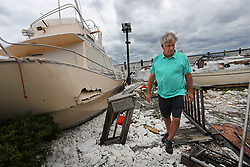 Local resident Jay Lassiter takes in the remains of a pile of boats, many under the water that can't be seen, after they were swept together and sank when their docks were destroyed as Hurricane Irma swept through the area on Monday, September 11, 2017, in St. Marys, GA, USA. Photo by Curtis Compton/Atlanta Journal-Constitution/TNS/ABACAPRESS.COM