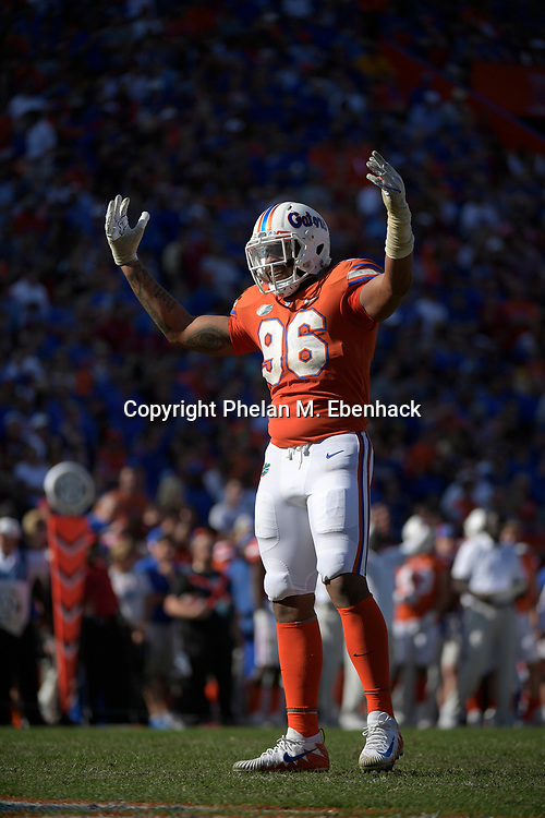 Florida defensive lineman Cece Jefferson (96) encourages the fans in the stands during the second half of an NCAA college football game against Florida State Saturday, Nov. 25, 2017, in Gainesville, Fla. FSU won 38-22. (Photo by Phelan M. Ebenhack)