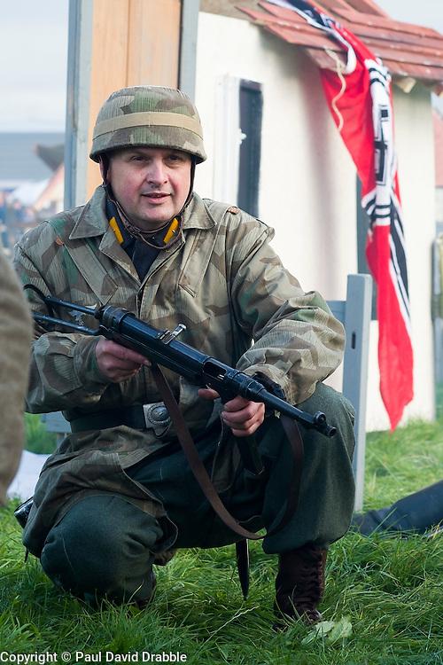 A Re-enactor portrayiing a fallschirmjager during a battle battle re-enactment in on Pickering Showground<br /> <br /> 17/18 October 2015<br />  Image © Paul David Drabble <br />  www.pauldaviddrabble.co.uk