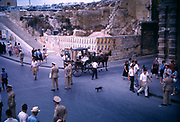 Street scene with horse drawn taxi in Valletta, Malta 1960s