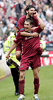 Paul Hartley and Rudi Skacel celebrate Hearts 4-0 win over Hibs. Photo: Tom Ross.<br />
