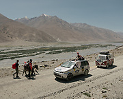 Tourists with their car on the Mongol Rally - linking United Kingdon to Mongolia.<br /> Trekking between Yamchun village and Darshai. Sights and places to see while walking along the Tajikistan side of the Wakhan Corridor.