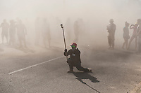 Videographer with GoPro camera in thick dust at finish of 2012 San Felipe Baja 250, San Felipe, Baja California, Mexico