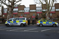 © Licensed to London News Pictures. 01/01/2019. London, UK. Police officers outside a house on John Ruskin Street in Camberwell, Southwark where a woman in her early 30s was stabbed to death early this morning. Photo credit: Dinendra Haria/LNP