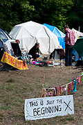 Balcombe, West Sussex. Site of Cuadrilla drilling . A group of tents pitched by the roadside with a sign saying'This is just the beginning'.