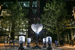 © Licensed to London News Pictures. 21/10/2021. Manchester, UK.  'Our Beating Heart', a heart-shaped mirrorball from artists Lucy McDonnell and Stephen Newby is displayed in Circle Square on the opening night of the 'Corridor of Light' festival in Manchester city centre. The new arts festival is designed as a celebration of the Oxford Road Corridor innovation district, an economically important area stretching south from St. Peter's Square which includes The University of Manchester, Manchester Metropolitan University, the Royal Northern College of Music and Manchester Science Park. Photo credit: Adam Vaughan/LNP