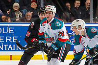 KELOWNA, CANADA - JANUARY 16:  Liam Kindree #26 of the Kelowna Rockets is checked by Daniil Stepanov #16 of the Moose Jaw Warriors on January 16, 2019 at Prospera Place in Kelowna, British Columbia, Canada.  (Photo by Marissa Baecker/Shoot the Breeze)